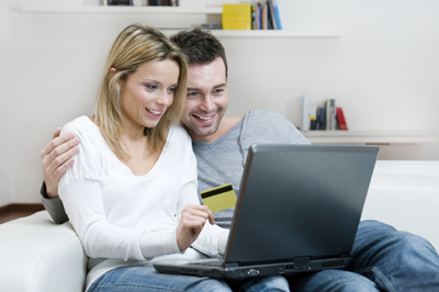 Couple making buying decision during internet shopping experience
