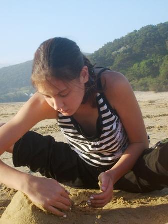 image of girl designing sand castle - Delightability