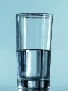 image of glass half full for taking action blog post - Delightability