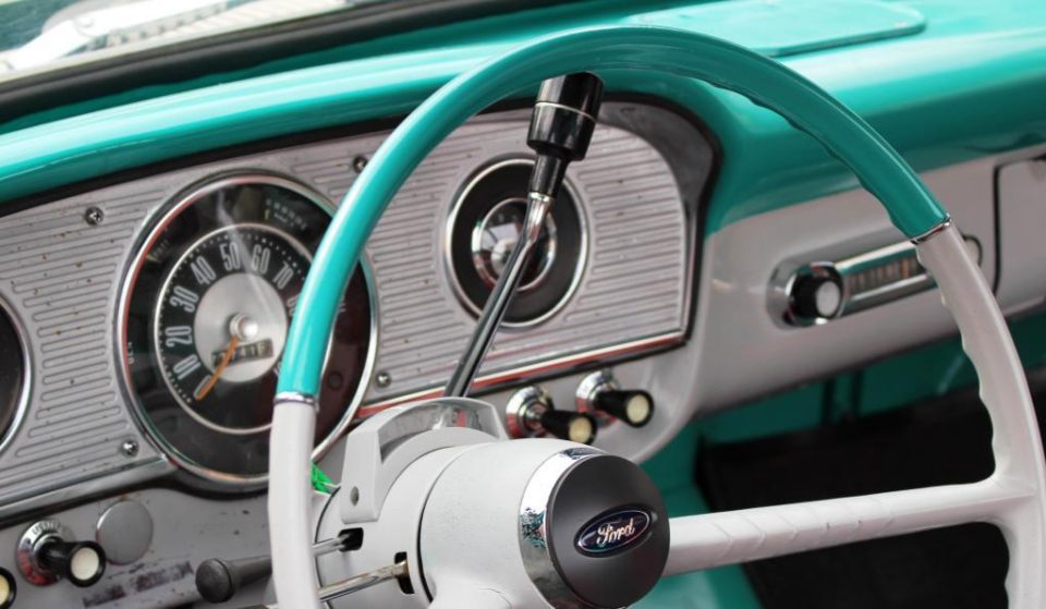 image of shifter on vintage steering wheel - delightability