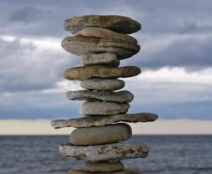 image of zen stacked stones as metaphor for finding balance-delightability
