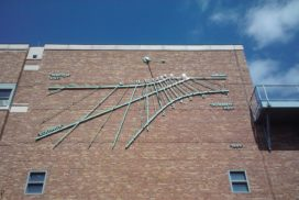 image of sundial on building at University of Washington - Gregory Olson