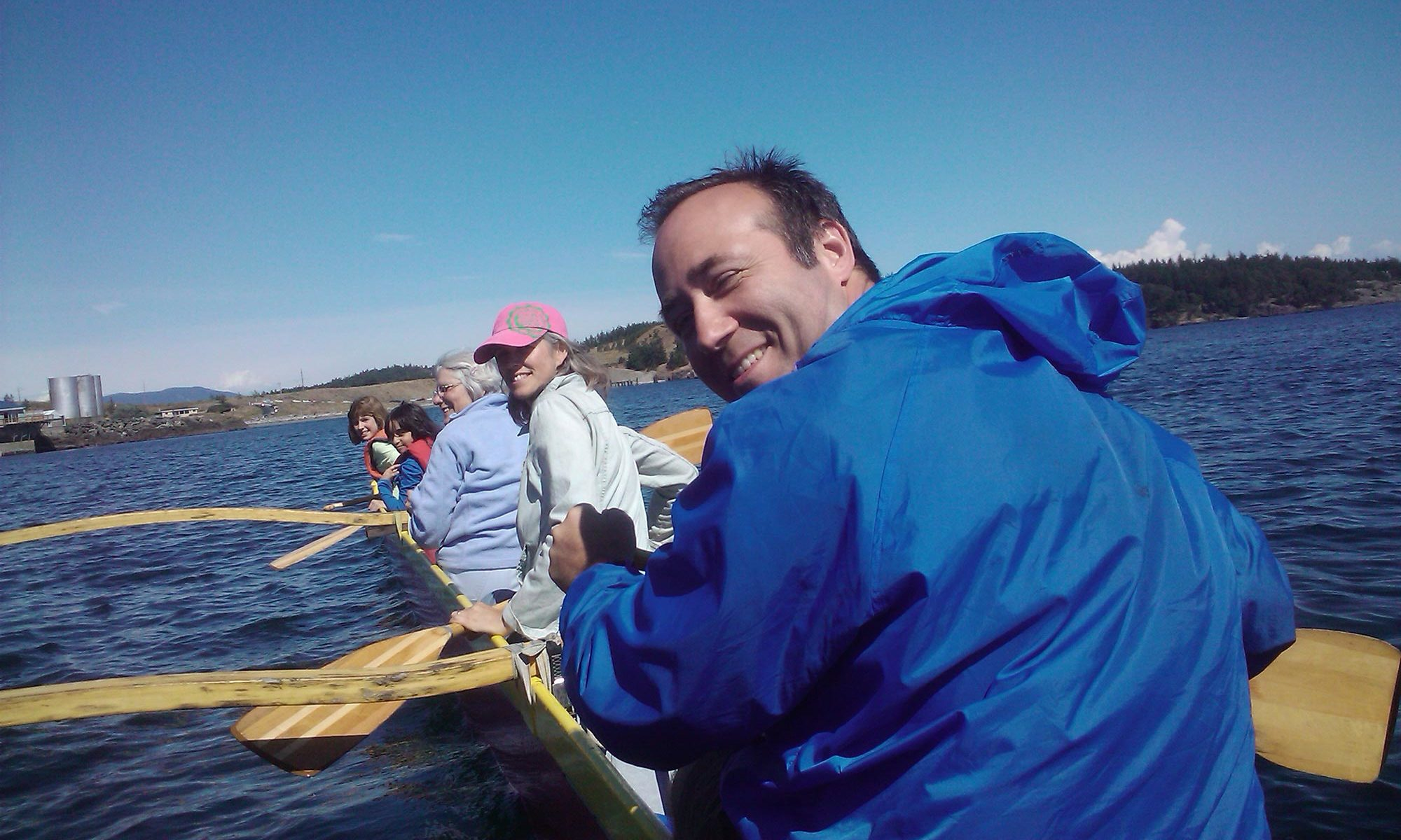 image of author Greg Olson on outrigger canoe on San Juan with Bauer family