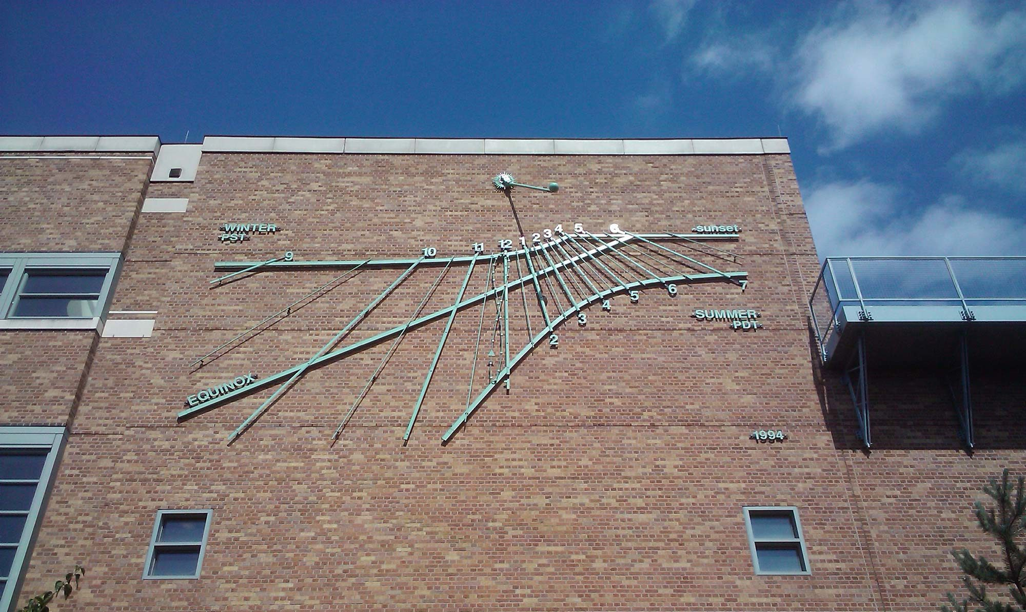 image of sundial on building at University of Washington - author Gregory Olson