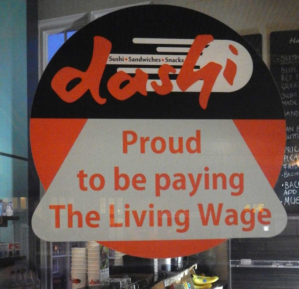 Image of Living Wage Sign in Dashi Sushi Coffee Shop Window - Bath England - better capitalism needed